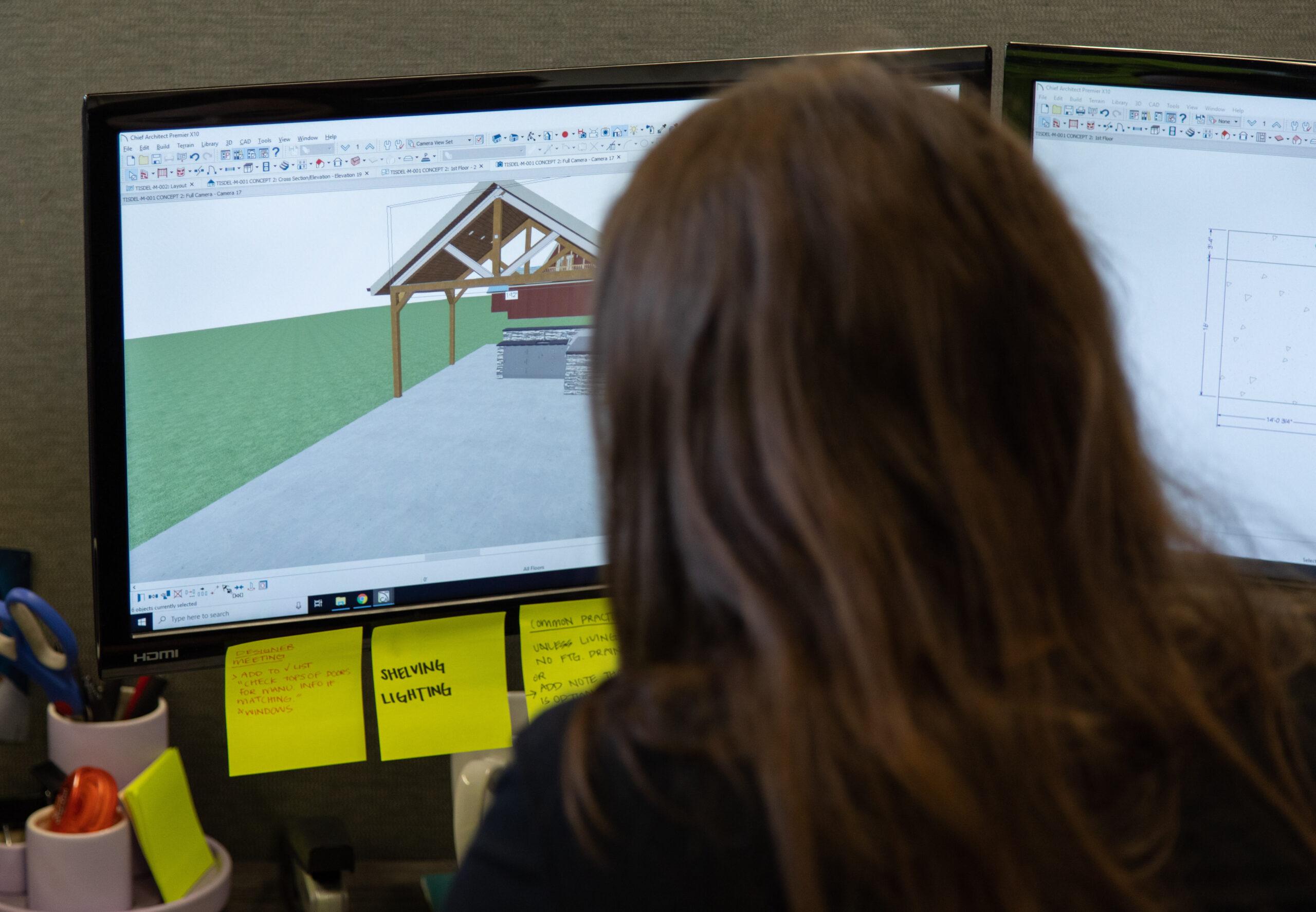 woman designing at desk