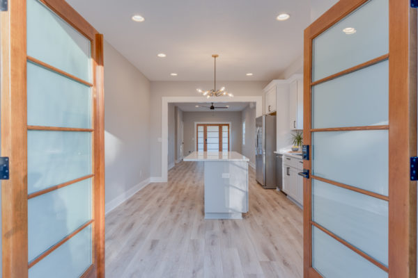 whole home remodel: doors opening to new space