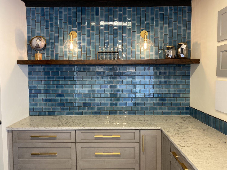 lamont bros showroom blue subway tiles