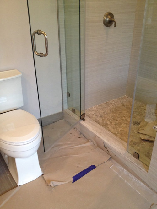 bathroom remodel mistakes: poor space planning where shower door hits toilet