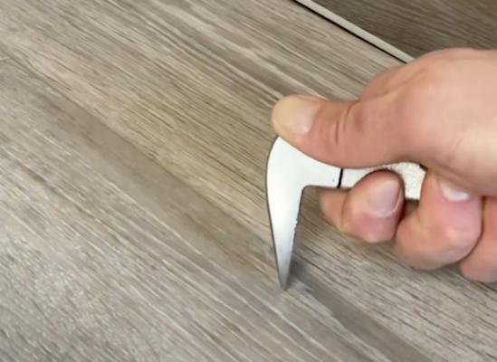 scratch resistant flooring test - Cat's Paw scratch test on laminate