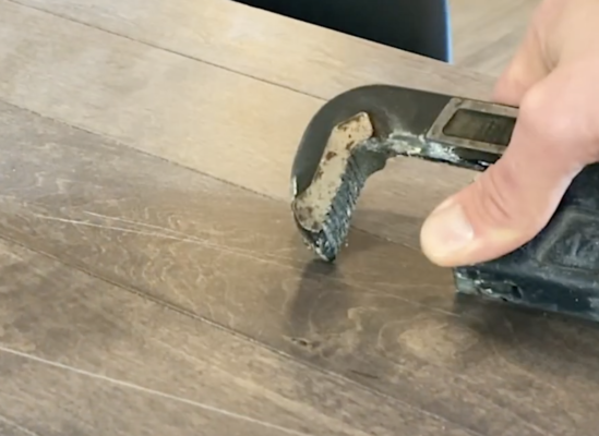scratch resistant flooring test - pipe wrench scratch test on maple hardwood