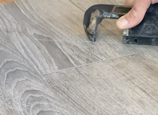 scratch resistant flooring test - pipe wrench scratch test on laminate
