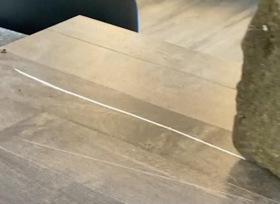 scratch resistant flooring test - rock scratch test on maple hardwood