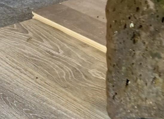 scratch resistant flooring test - rock scratch test on luxury vinyl plank