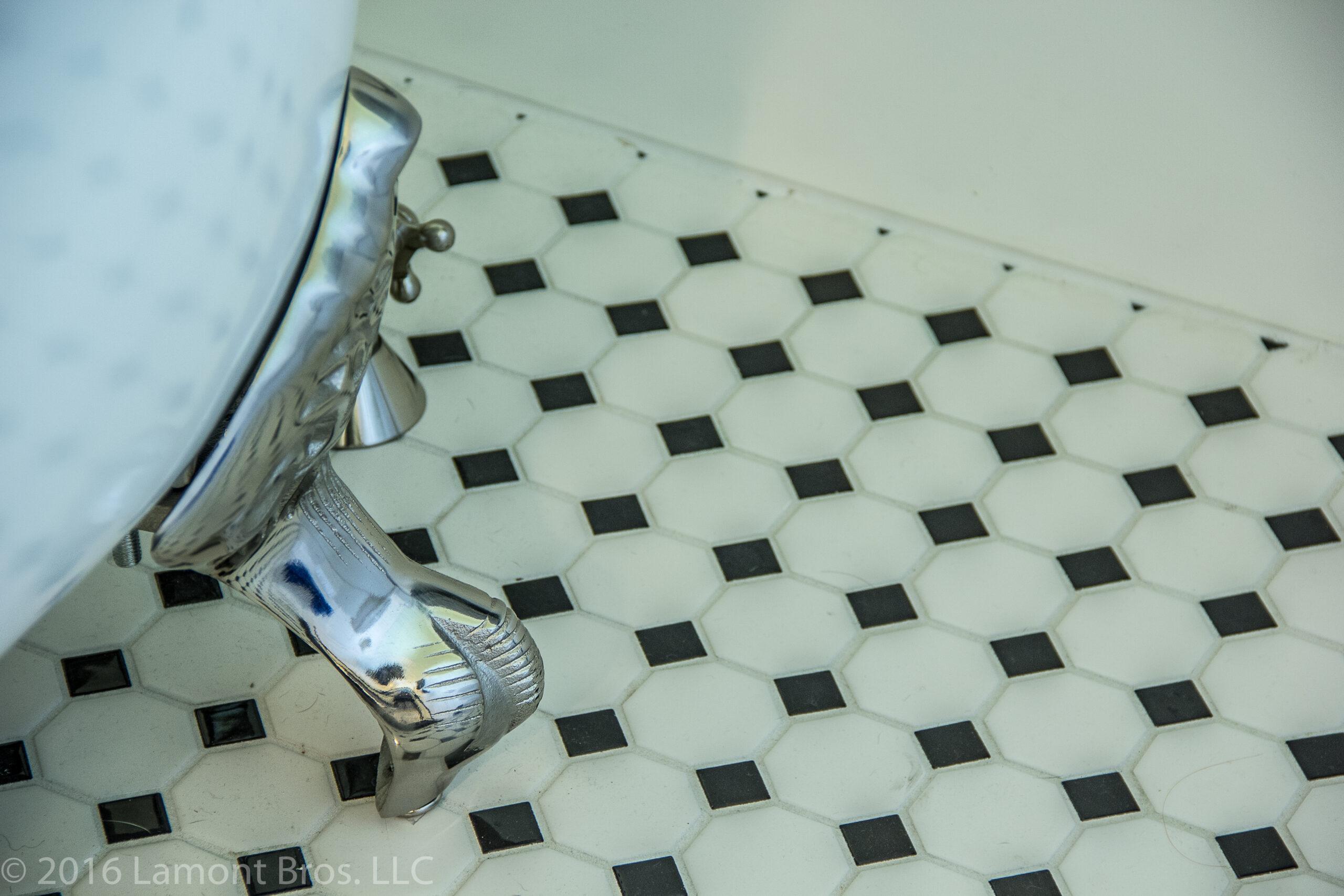 bathroom tile floor and clawfoot tub