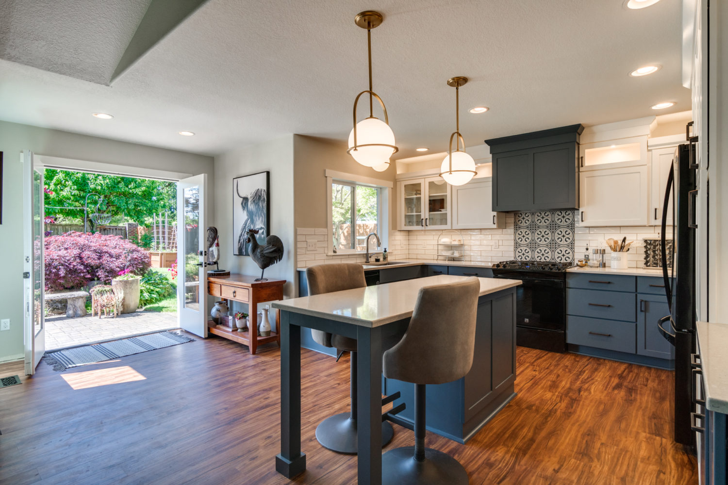 blue kitchen with pendant lights