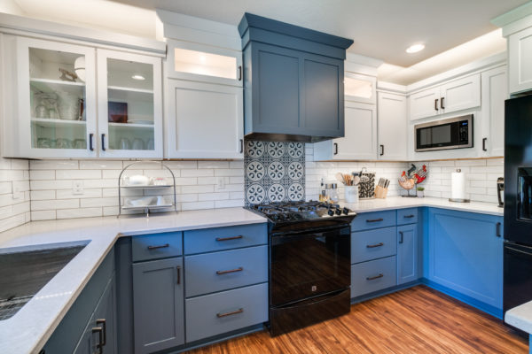 blue kitchen with bold tile backsplash