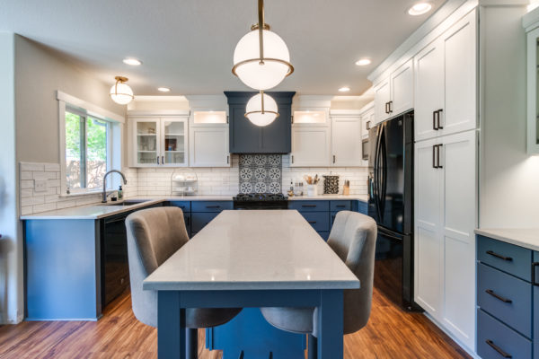kitchen remodel with island and round pendant lights