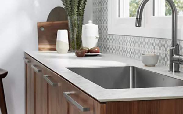 kitchen remodel costs: thinscape counter in white with wood cabinets