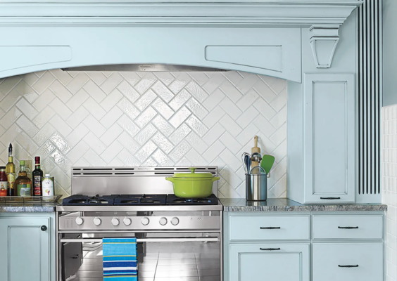 subway tile surrounded by colorful cabinets